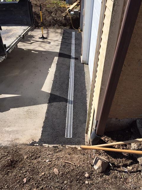 Driveway trench drains groundhog excavating ltd for Driveway trench drain